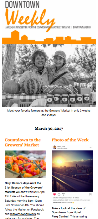 An image with a picture of two persons hugging in front of vegetables at the growers' market. A title Countdown to the Growers' Market and another Title Photo of the Week
